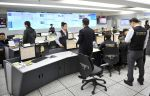 Members of the Korea Internet Security Agency (KISA) check on cyber a